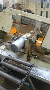 Cutting some of the aluminium stock into a section that will remain in CUED and one to be sent to WPPE